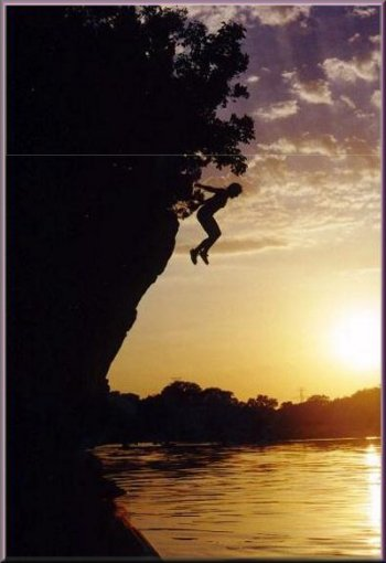 Carolee Doty jumping from the cliffs into the Brazos River