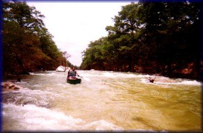 Marc running the rapids on the Blanco River, 2001