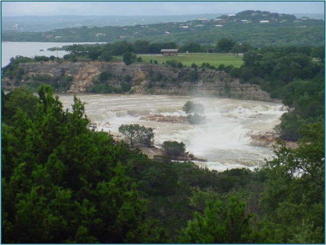 Water from the spillway comes roaring toward Horseshoe Falls Estates and the Lower Guadalupe River