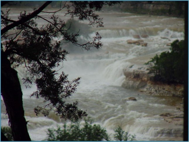 Close-up view of the water pouring over the spillway at Canyon Lake